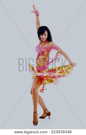 Belly dancer isolated on a white background.
