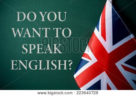 a flag of the United Kingdom and the question do you want to speak English? against a dark green background