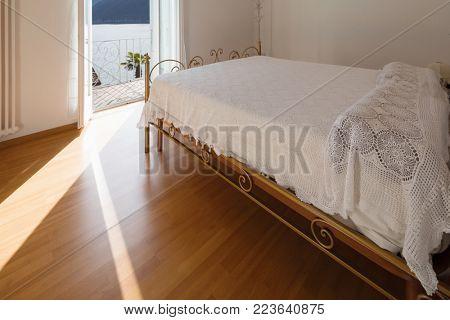 Master bedroom with fantastic lake views. Romantic