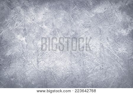 Worn metal plate steel background. Silver foil.