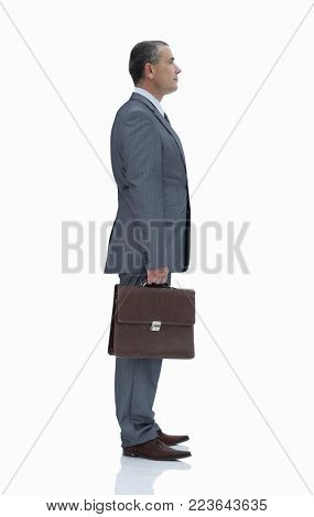 side view.confident businessman with briefcase.