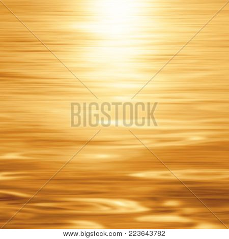 Gold water surface background - abstract blurred sunset background at the beach