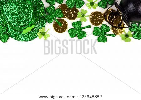 St Patricks Day top border isolated on a white background. Above view with Pot of Gold, shamrocks and leprechaun hat.