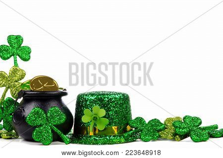 St Patricks Day Pot of Gold, shamrocks and leprechaun hat. Corner border over a white background.