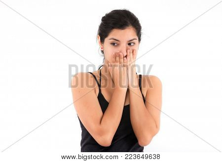 Fear emotional girl on a light background