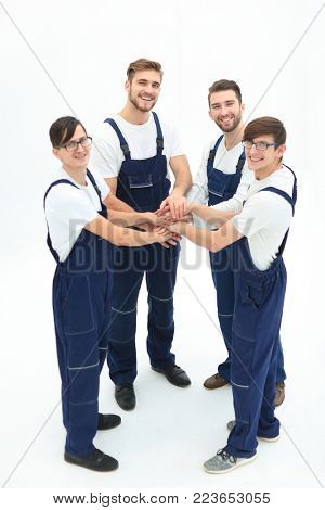 Team of movers joining hands.