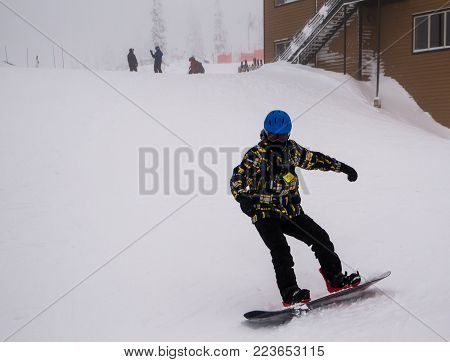 The angular athleticism displayed by the single snowboarder as he heads towards the camera.