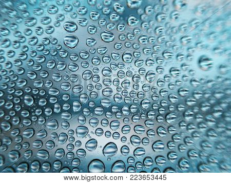 Droplet of water as background / Water is a transparent and nearly colorless chemical substance that is the main constituent of Earth's streams, lakes, and oceans, and the fluids of most living organisms