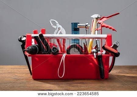 Toolbox With Different Worktools Against Grey Background