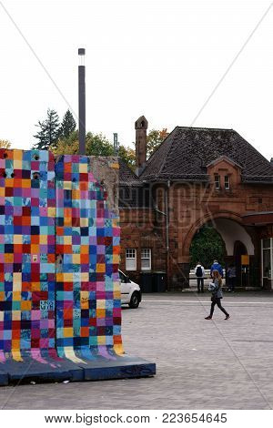GIESSEN, GERMANY - SEPTEMBER 30: Colorfully painted sections and segments of the Berlin Wall stand on the forecourt of Giessen main train station on September 30, 2017 in Giessen.