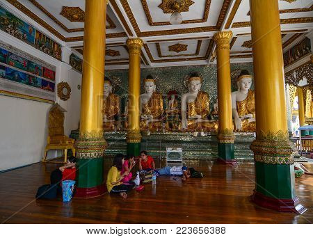 Yangon, Myanmar - Feb 26, 2016. People Praying At Shwedagon Pagoda In Yangon, Myanmar. The Pagoda Is