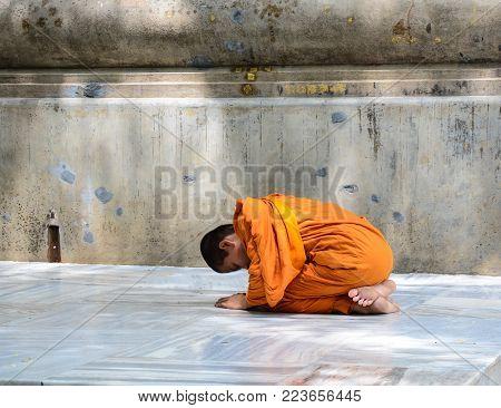 Bodhgaya, India - May 5, 2015. A Novice Praying At Mahabodhi Temple Complex In Bodhgaya, India.