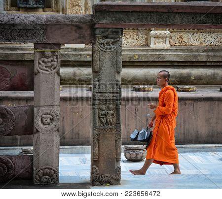 Bodhgaya, India - Jul 9, 2015. A Monk Walking At Mahabodhi Temple In Bodhgaya, India. Mahabodhi Mark