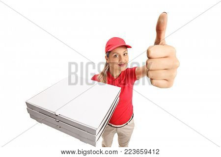 Pizza delivery girl holding a stack of pizza boxes and making a thumb up gesture isolated on white background