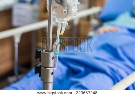 Saline bag and drip set for intravenous infusion for patient in modern hospital, selective focus on drip set