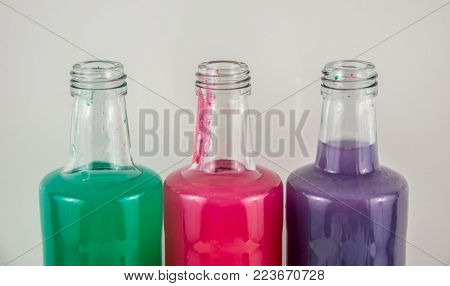 three colors in flasks , blue, red, green three colors in flasks , blue, red, green conceptual