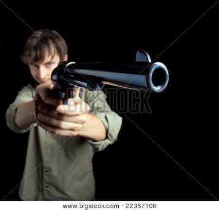Man pointing a big revolver
