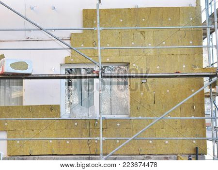 House External Wall Insulation with Fiberglass. Energy Saving Concept. Fiber glass insulation delivers proven performance  at a greater value compared to other types of insulation materials.