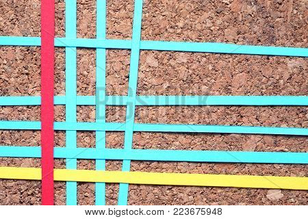 Lot of color paper lines in a row on wooden background