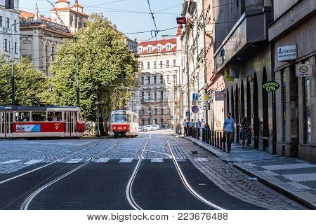 Prague,  Czech Republic - August 18, 2017: Red tramways in square in historic centre of Prague.
