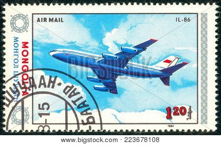 Ukraine - circa 2018: A postage stamp printed in Mongolia show aircraft Il-86. Series: Airplanes. Circa 1984