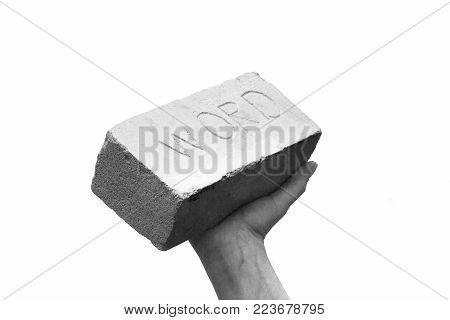 brick or stone bar in hand with stamp word. the word has weight or keep your word or keep your promise concept