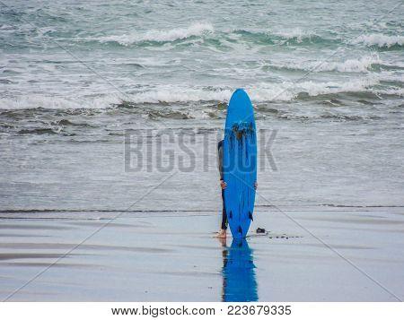 Surfing at Maukatia (Maori Bay) and Muriwai Beach. Auckland, New Zealand