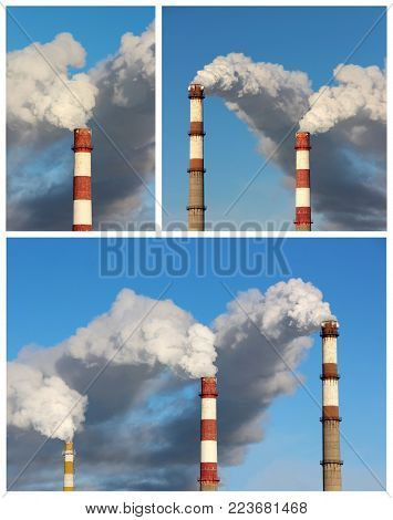 Dense clouds of smoke or vapor out of the three factory chimneys on background of blue sky. The concept of ecology, pollution of the environment.