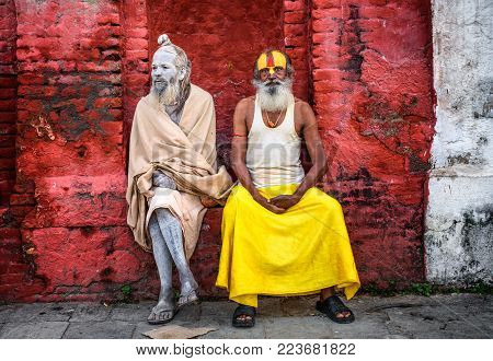 KATHMANDU, NEPAL - OCTOBER 21, 2015 : Wandering Shaiva sadhus with traditional face paintings in ancient Pashupatinath Temple