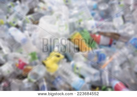 Selective focus of plastic bottle in recycle bin,waste management material concept.