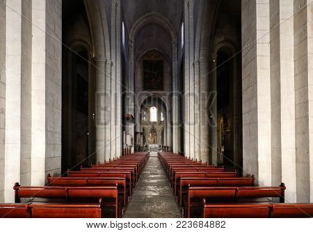 Arles, France - June 27, 2017: Main nave and altar in Saint Trophime Cathedral in Arles, France. Bouches-du-Rhone,  France