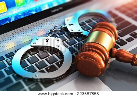 3D render illustration of the macro view of metal handcuffs and wooden judge mallet, gavel or hammer on laptop notebook computer keyboard with selective focus effect