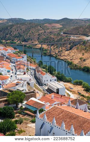 The view of Mertola city on the riverside of Guadiana with the bridge over the river on the background. Baixo Alentejo. Portugal
