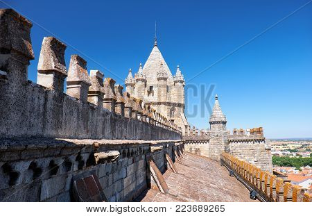 The view of roof slope with lantern tower and battlements on the Evora (Se) cathedral (Basilica Cathedral of Our Lady of Assumption). Evora. Portugal