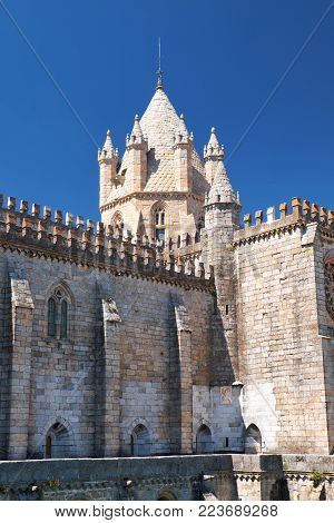Lantern-tower surrounded by six turrets over the crossing of Cathedral (Se) – Basilica Cathedral of Our Lady of Assumption. Evora. Portugal.