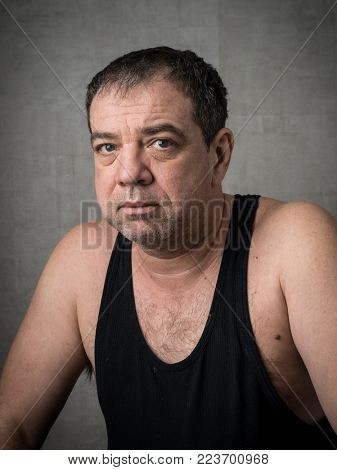 Adult tired sad man in black T-shirt portrait
