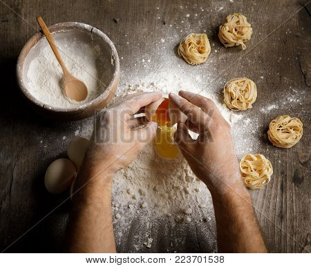 Close up view of baker kneading dough. Homemade bread. Hands preparing bread dough on wooden table. Preparing traditional homemade bread.