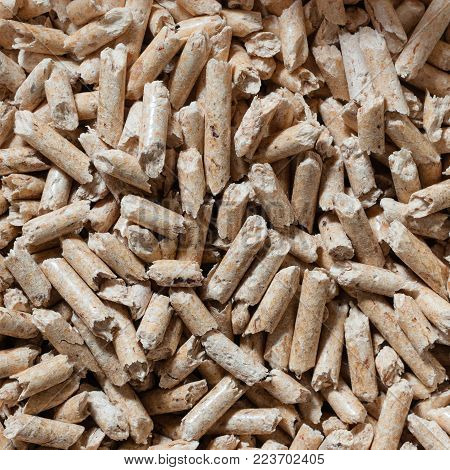 Close up of natural wood pellets for heating. Square composition.