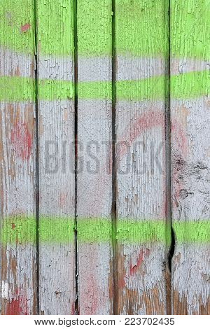 Colored wood wall. The shabby wood wall stained with white and green paints.