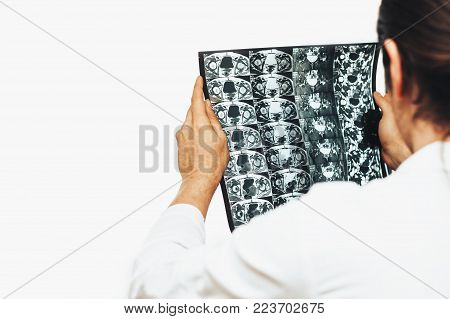 Doctor holds MRI scan or X-Ray film of heap joint in his hands, copy space