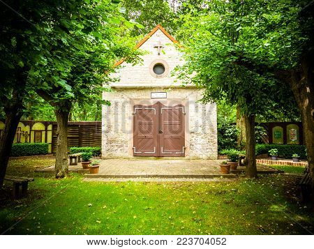 the small chapel in spring in the forest without people