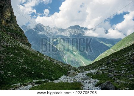 amazing green mountains and clouds, Ala Archa National Park, Kyrgyzstan