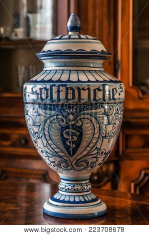 An old ceramic pharmacy jar hand painted. The word 'solforiche' means sulfuric in italian.