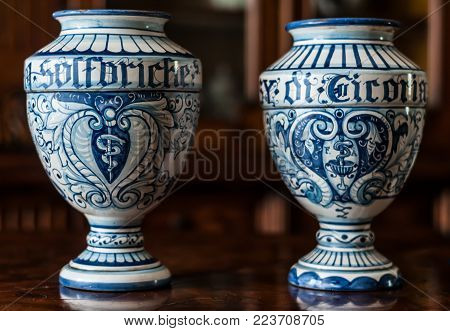 Two old italian ceramic pharmacy jars hand painted. The word 'sulfuriche' on the first one means sulfuric, the word 'cicoria' on the secon one means chicory.