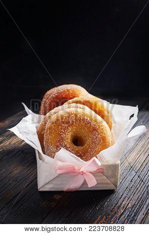 Graffe - tipical carnival italian doughnut  on black wooden board, copy space.