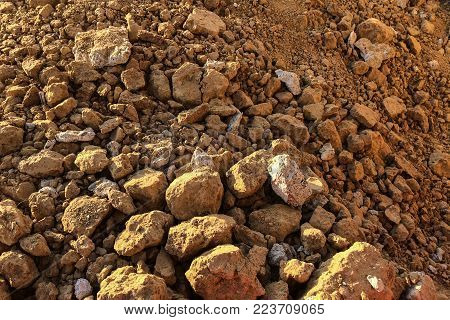 Arid clay soil in a construction site. Horizontal composition.