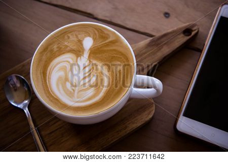 coffee aroma latte art cup on wood table relaxtime in cafe coffee shop