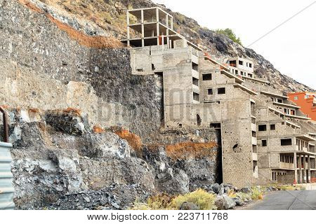 construction of residential apartments in the mountains on steep slopes. Los Gigantes Cliffs, Tenerife, Spain