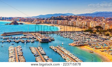 BLANES , SPAIN - MARCH 12: Marina, beach and seafront of the town of Blanes, Costa Brava, Catalonia, Spain