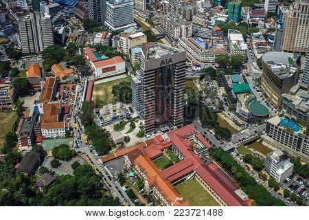Kuala Lumpur, Malaysia : March, 2017 - Urban views of Kuala Lumpur with tall skyscrapers, drowning in the greenery of parks